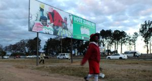 A child walks past an election billboard for Zimbabwe's President Robert Mugabe's Zanu-PF party in the capital Harare. Photograph: Philimon Bulawayo/Reuters