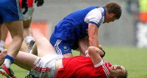 Monaghan's Dessie Mone gets to grips with Colm Cavanagh of Tyrone. Photograph: Ryan Byrne/Inpho