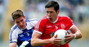 Monaghan's Darren Hughes chases man-of-the-match Seán Cavanagh of Tyrone at Croke Park. Photograph: Ryan Byrne/Inpho