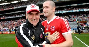 Tyrone manager Mickey Harte and Stephen O'Neill celebrate after their quarter-final win over Monaghan. Photograph: Ryan Byrne/Inpho