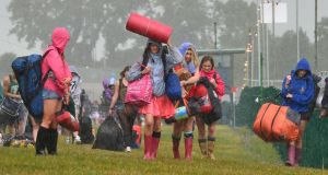 Rain pours down on campers arriving to Punchestown.  Photograph: Alan Betson/The Irish Times
