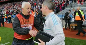 Dublin manager Jim Gavin is congratulated by his Cork counterpart Conor Counihan at Croke Park on Saturday night. Photograph: Morgan Treacy/Inpho