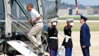 President Barack Obama boards Marine One to fly to Camp David yesterday at Andrews AirForce Base. Photograph: Getty