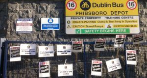Placards are seen outside the Dublin Bus depot outside Phibsboro this morning.