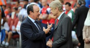 Napoli manager Rafael Benitez (left) and Arsenal manager Arsene Wenger speak before kick-off during the Emirates Cup 2013 match at the Emirates Stadium Photograph: PA Wire.