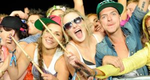Fans Cara Cottam, Nicole Gleeson and Sean Og Maguire from Tipperary enjoy Calvin Harris's performance at Oxegen. Photograph: Patrick O'Leary