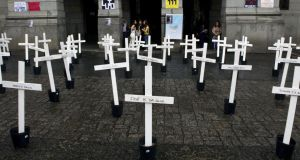 Crosses stand at the University of Sao Paulo  in memory of the 111 inmates killed in a clampdown of a prison rebellion at the Carandiru Penitentiary in the city in 1992. Photograph: Nelson Almeida