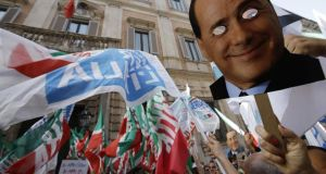 Protesters gather during a demonstration organised by the PDL party for its leader Silvio Berlusconi in front of his Rome residence yesterday. Photograph: AP Photo/Andrew Medichini