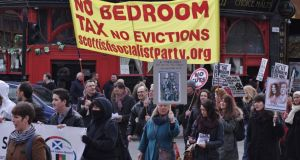 "Protesters carry a Scottish Socialist Party banner at the Glasgow protest against the ""bedroom tax"" levied on dwellings deemed underoccupied. Photograph: John Lanigan"