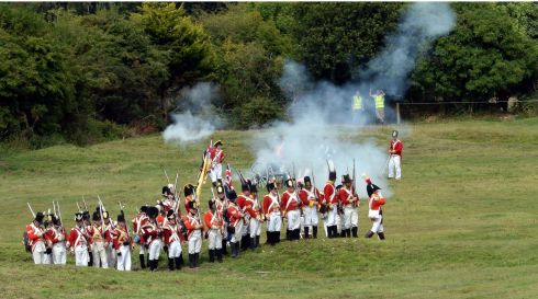 The Red Coats (British Army) open fire on the Irish Rebellions during the re-enactment of the Battle of Vinegar Hill. Photograph: Brenda Fitzsimons/The Irish Times