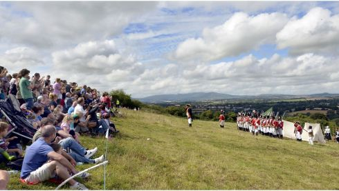 Spectators watch the Red Coats during the re-enactment of the Battle of Vinegar Hill. Photograph: Brenda Fitzsimons/The Irish Times