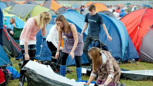 Punters setting up tents in the campsite on the first day of Oxegen. Photograph:  Collins Photos