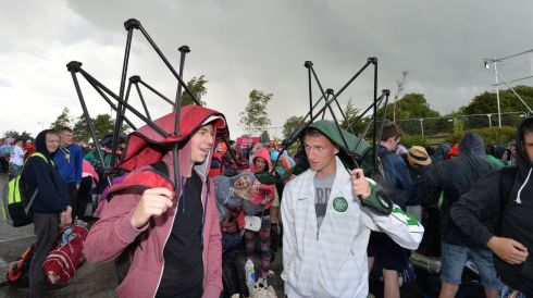 Rob Moran and Dean Campbell  from Naas shelter from the rain. Photograph: Alan Betson/The Irish Times