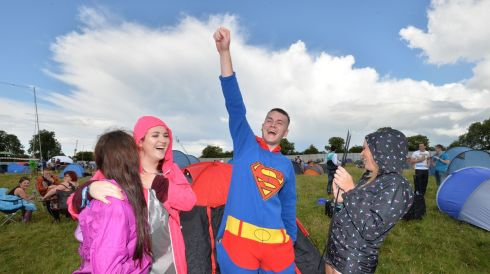 Superman aka Aidan Twomey, comes to the rescue of Molly Murphy, Ciara Dalton and Simone Black.  Photograph: Alan Betson/The Irish Times