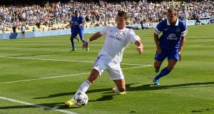Cristiano Ronaldo of Real Madrid tracked by Everton defender Philip Jagielka during  the 2013 Guinness International Champions Cup at Dodger Stadium on Saturday.  Photograph: Kevork Djansezian/Getty Images