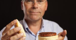 Dutch scientist Mark Post with the world's first test-tube burger. Photograph: David Parry/PA Wire