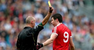 Tyrone's Seán Cavanagh is yellow carded by referee Cormac Reilly at Croke Park. Photograph: Ryan Byrne/Inpho