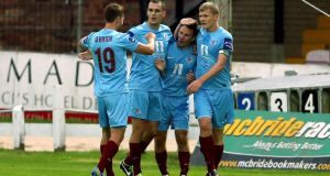 Drogheda United's David Cassidy (second right)  celebrates with his team-mates after scoring against Derry City at the Brandywell. Phogograph: William Chrerry/Presseye/Inpho