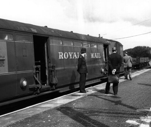 Investigators examine the Royal Mail train involved in the Great Train Robbery.  (Photo by Evening Standard/Getty Images)