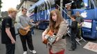 Music students from Dundalk Youth Centre taking part in a workshop on the John Lennon Music Mobile an Education Tour Bus. Engineer Jamie Thompson, Conor Loughnan and Kate Rogers play outside the bus at the National Concert Hall today. Photograph: Cyril Byrne/The Irish Times