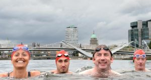 Lord Mayor of Dublin Oisín Quinn is joined other swimmers including Claire Cantrell, Shane Drumm and  Tom Loftus in the River Liffey  during the launch of the 94th Dublin City Liffey Swim today. Photograph: Dara Mac Dónaill/The Irish Times