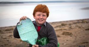 Last year, schoolboy Oisín Millea found the mystery message in a bottle, which had been tossed into the Atlantic Ocean in Canada in June 2004, by two 12-year-old friends while on holiday in Grande Vallée, Québec. Photograph: Dylan Vaughan