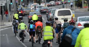 Cyclists on the North Strand Road, Dublin, yesterday  as the bus strike continued for a third day. The lack of buses was  felt acutely  as workers returned to the city after the bank holiday weekend. Photograph: Dara Mac Dónaill