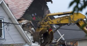 A crane demolishes the home of Ariel Castro in Cleveland, Ohio, today. Photograph: Getty