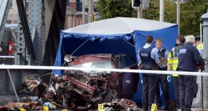 The scene of the crash on Monday where a hijacked taxi crashed at the North Wall killing two of the three occupants. Photograph: Brenda Fitzsimons/The Irish Times