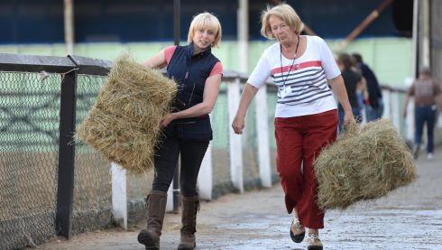 Christina Lawrence and Julie Cuddy, from Middleton, Co Cork, carry bales during the opening day of the Discover Ireland Dublin Horse Show in the RDS. All photographs: Dara Mac Donaill.