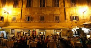 "Customers eat dinner at a restaurant in downtown Rome this week. ""The main obstacle to growth in Italy is the government."" Photograph: Reuters"