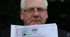 Michael Gallagher, who lost his son Aidan in the Omagh bomb attack, holds a redacted email from a Real IRA mole during a press conference on behalf of the Omagh Bomb Survivors group yesterday. Photograph: Niall Carson/PA