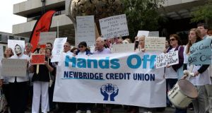 Newbridge Credit Union Action Group protest outside the Central Bank in Dublin today. They are opposing the forced merger of Newbridge Credit Union with the Naas branch. Photograph: Brenda Fitzsimons/The Irish Times