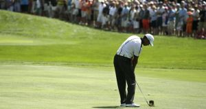 Tiger Woods plays his approach to the first hole during the third round of the US PGA Championship
