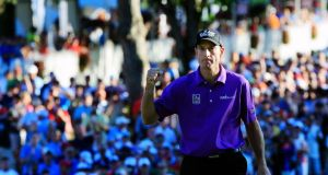 Jim Furyk celebrates after saving par on the 18th green. Photograph: Sam Greenwood/Getty Images