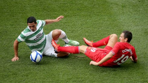 Liverpool's Stewart Downing and Beram Kayal of Celtic. Photo : INPHO/Cathal Noonan