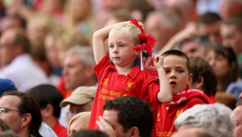A young Liverpool supporter looks on during the game. Photo : INPHO/Cathal Noonan