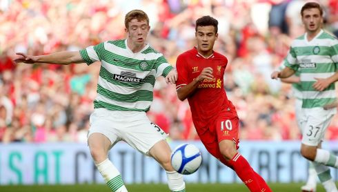 Liverpool's Philippe Coutinho and Stuart Findlay of Celtic. Photo : INPHO/Ryan Byrne