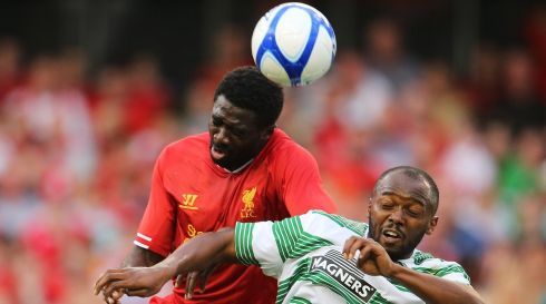 Liverpool's Kolo Toure and Steven Mouyokolo of Celtic. Photo : INPHO/Cathal Noonan