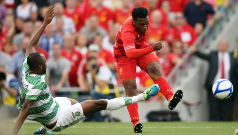 Liverpool's Daniel Sturridge and Steven Mouyokolo of Celtic. Photo :INPHO/Cathal Noonan