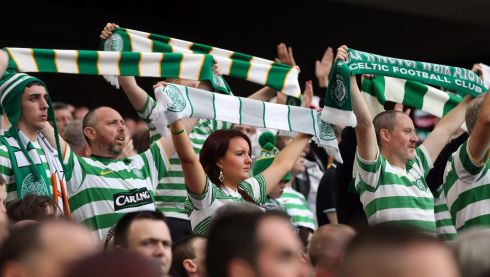 Celtic supporters celebrate their win. Photo : INPHO/Cathal Noonan