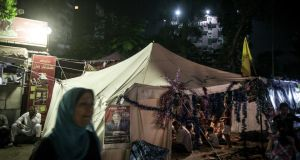 People gather at a tent during a sit-in near the Rabaah al-Adawiya mosque in the Nasr City neighborhood of Cairo. Photograph: Narciso Contreras/The New York Times
