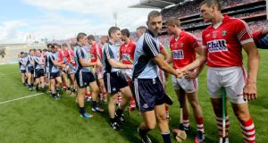 Dublin and Cork teams shake hands before the game. Photograph: Inpho.