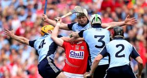 Dublin's Paul Schutte, Peter Kelly, Niall Corcoran and Liam Rushe have Patrick Horgan of Cork surrounded. Photograph: Inpho.