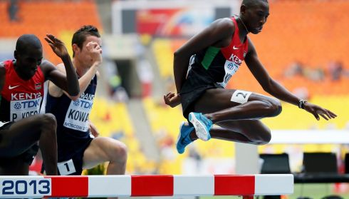 Conseslus Kipruto (right) of Kenya clears a hurdle in the men's 3000 metres steeplechase . Photograph: Lucy Nicholson/Reuters