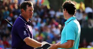 Lee Westwood  and Rory McIlroy shake hands on the 18th hole after playing together in the   final round of the USPGA Championship at Oahk Hill in Rochester, New York. Photograph: Rob Carr/Getty Images