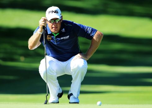 Lee Westwood of England lines up a putt on the 16th green during the third round. Photograph: David Cannon/Getty Images