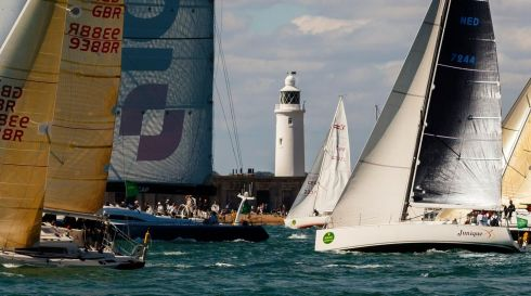 The British yacht ICAP Leopard cuts through the fleet as they pass Hurst Light in the eastern Solent during the 45th Rolex Fastnet Race on the Solent, near Cowes, Isle of Wight. Photograph: Chris Ison/PA Wire