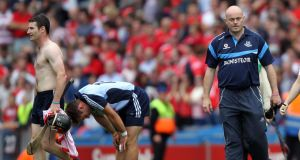 Dublin manager Anthony Daly moves to console his crestfallen players following Sunday's All-Ireland semi-final defeat to Cork at Croke Park.  Colm O'Neill/Inpho