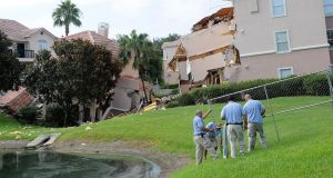 Summer Bay Resort employees install barricades around the collapsed building by a sinkhole at Summer Bay Resort near Walt Disney World on August 12, 2013 in Clermont, Florida. Photograph: by Gerardo Mora/Getty Images